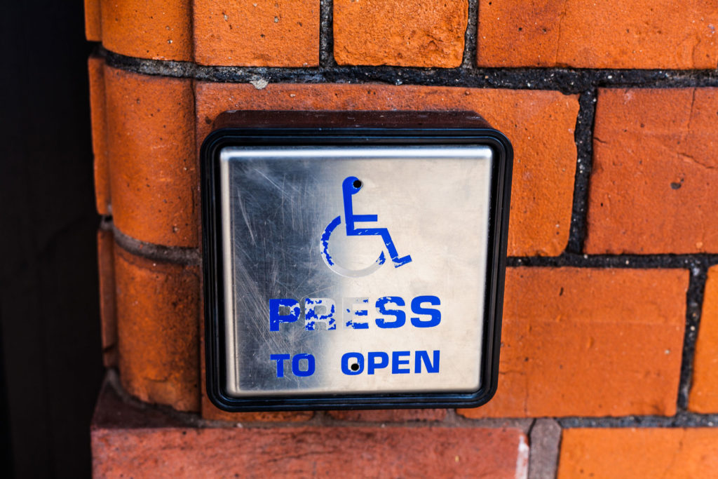 Press to open Handicap Access Button on Brick Wall